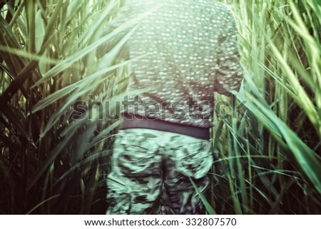 man runs away, the view from the back on the move - stock photo