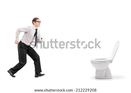 Man rushing to a urinal and holding toilet paper isolated on white background - stock photo