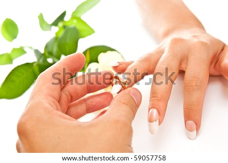 Man's and woman's hands with golden ring on white background - stock photo