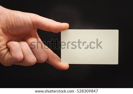 Man's arm hold blank business card. Template.