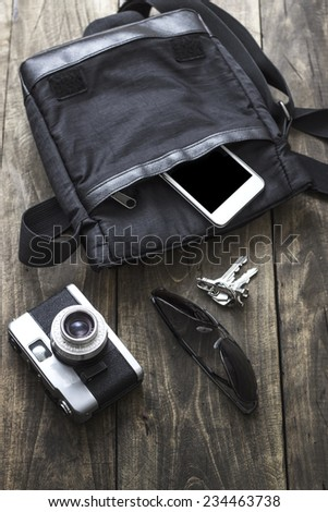 Man's bag and various personal items ,Overhead view. - stock photo
