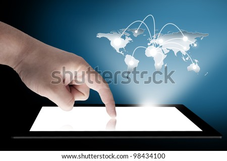 Man's finger pointing on the touch screen tablet PC with 3D world map raising from the screen. Concept for connectivity - stock photo