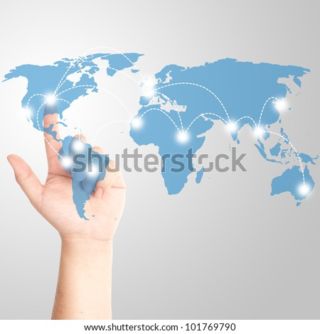 Man's finger touching on the touch screen with world map for social and internet connectivity concept - stock photo