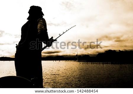 man 's fishing - stock photo