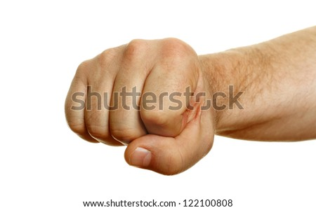 Man`s fist on white surface.