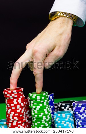 Man's hand and stairs of the chips. step Forward