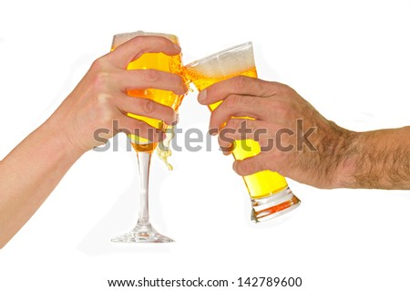 man's hand and woman with glasses of beer toasting - stock photo