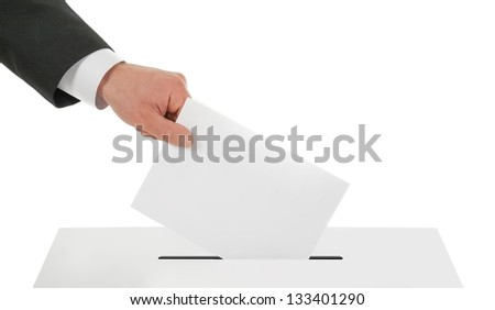 Man's hand down the ballot in the ballot box. Isolated on white - stock photo