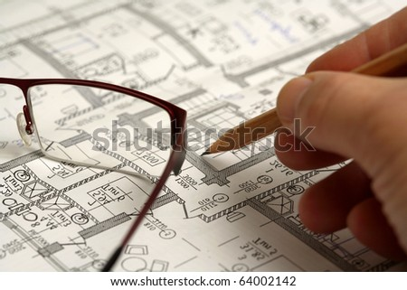 Man's hand draws a pencil business plan draft, with glasses - stock photo