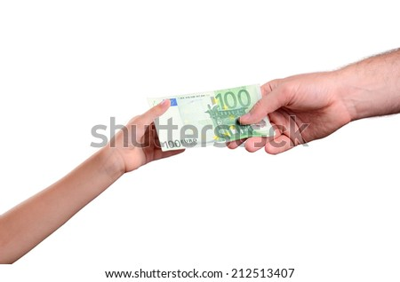 man's hand gives a the bill 100 euro in a child's hand. isolated on white background. horizontal