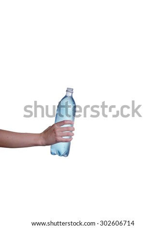 Man's hand holding a bottle of water - stock photo