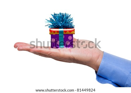 Man's hand holding a gift - stock photo