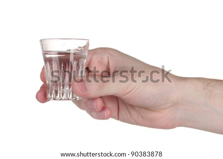 Man's hand holding a glass with vodka isolated on white