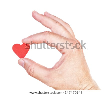 Man's hand holding a human heart. Symbol of health and love. - stock photo