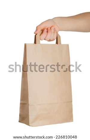 Man's hand holding a paper bag isolated on a white - stock photo