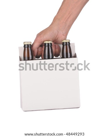 Man's Hand holding a six pack of brown beer bottles isolated over a white background - stock photo