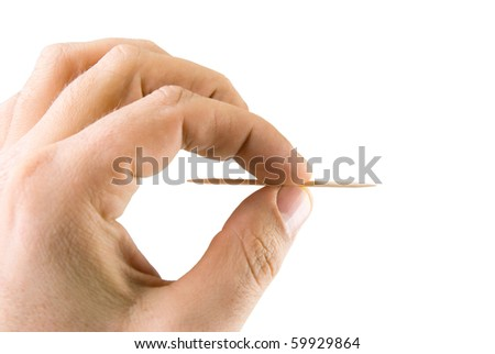 man's hand holding a toothpick. Isolated on white