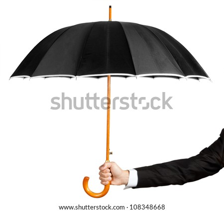 Man's hand holding an umbrella - stock photo
