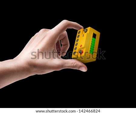 Man's hand holding Battery car isolated on balck background - stock photo