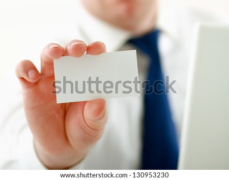 Man's hand holding blank white business card - stock photo