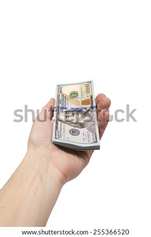 man's hand holding bundle of US dollar bills isolated over white  - stock photo