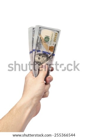 man's hand holding bundle of US dollar bills isolated over white