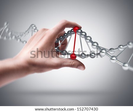 Man's hand holding capsule with Sample DNA  - stock photo