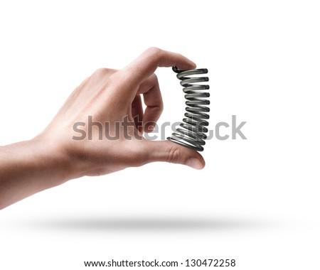 Man's hand holding chrome spring isolated on white background - stock photo