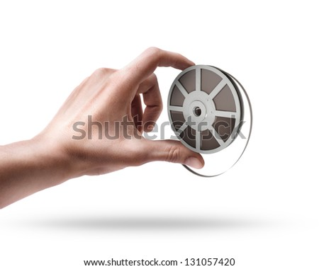 Man's hand holding Cinema film roll and strip isolated on white background - stock photo