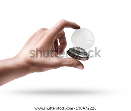 Man's hand holding empty crystal ball isolated on white background - stock photo