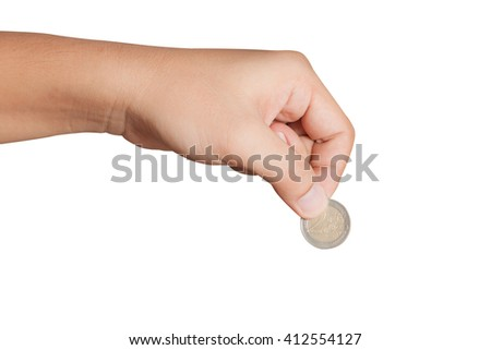 Man's hand, holding 2 Euros coin isolated on white background