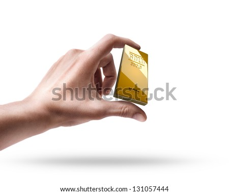 Man's hand holding golden bar isolated on white background - stock photo