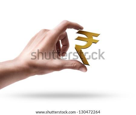Man's hand holding Golden Indian rupee simbol isolated on white background - stock photo
