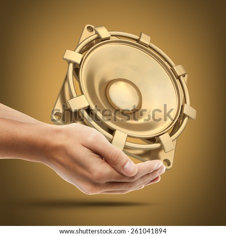 Man's hand holding golden Loudspeaker. High resolution 3D. collection of gold objects