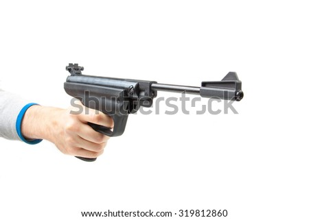 Man's hand holding gun, isolated on white background. - stock photo