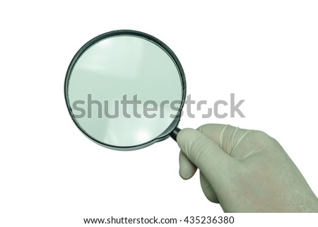 Man's hand holding magnifier in white background.