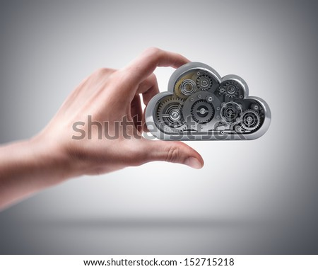 Man's hand holding metal cloud - stock photo