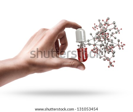 Man's hand holding pill with molecule structure isolated on white background - stock photo
