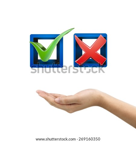 man's hand holding red and green check mark icons over white background - stock photo