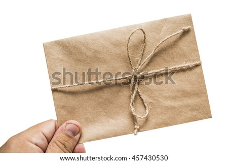 man's hand holding retro old vintage envelopes without letters isolated on the gray background. rope wrapped around in a knot