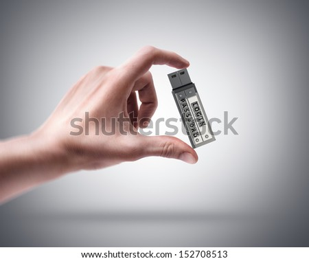 Man's hand holding Secure usb key device with password and login