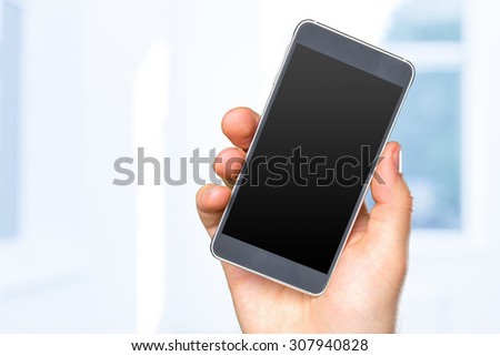 Man's hand holding smartphone