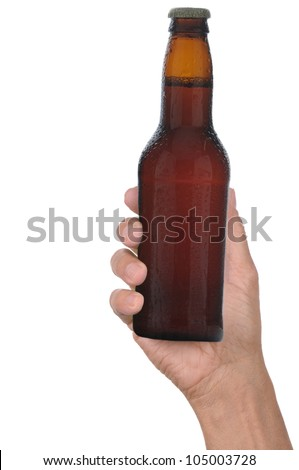Man's hand holding up a brown beer bottle without label over a white background vertical format - stock photo