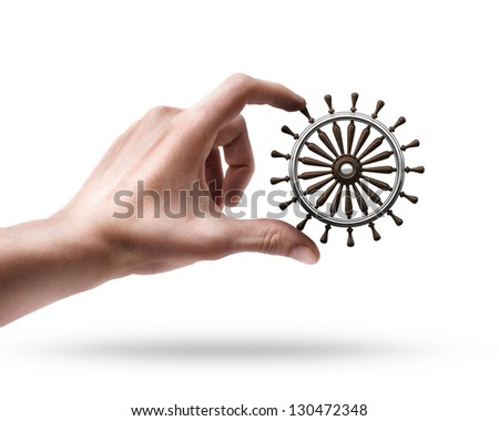 Man's hand holding wooden steering-wheel isolated on white background - stock photo