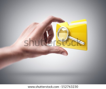 Man's hand holding Yellow folder with a symbol - stock photo