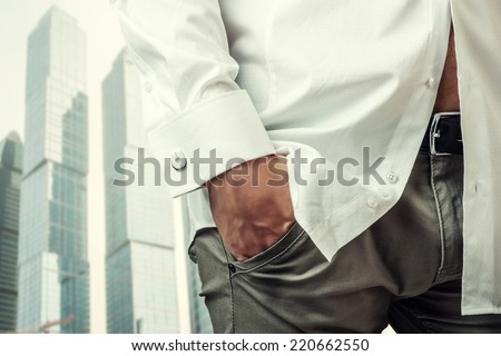 Man's hand in a white shirt with cufflinks in a pants pocket closeup. Tonal correction - stock photo