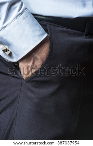 Man's hand in the pocket, closeup. - stock photo