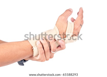 Man's Hand in Wrist Brace Due to His Wrist Pains - stock photo