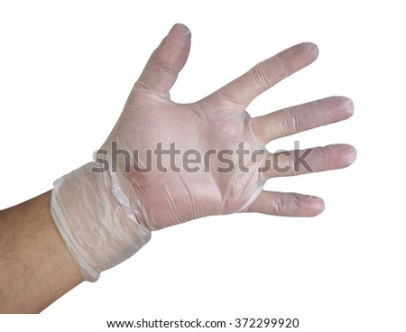 Man's hand into disposable plastic glove isolated on white. Clipping path included. - stock photo