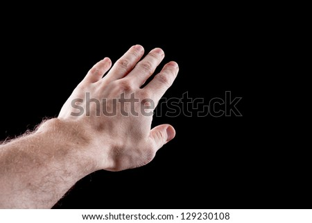Man's hand isolated on black background